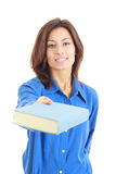 Young woman offering or giving book stock photo