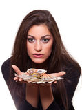 Young woman offering money. Beautiful young woman offering money, selective focus on Money, isolated on white background Royalty Free Stock Images