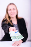 Young woman offering money Royalty Free Stock Photography
