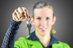 Young woman offering you house keys Stock Photography
