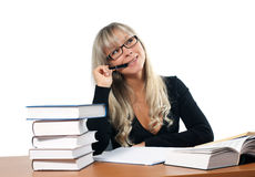 Young woman in office. Young woman in black dress in office royalty free stock photo