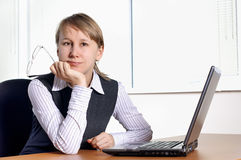 Young woman in office. With laptop and glasses stock image
