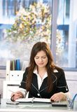 Young woman in office Royalty Free Stock Photography