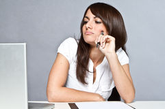 Young woman in office Royalty Free Stock Photo