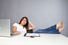 Young woman in office Stock Images