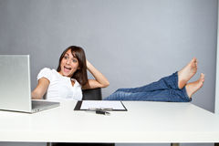 Young woman in office Stock Photos