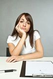 Young woman in office Stock Photo