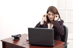 Young woman at the office. Young lady is preparing to work on her laptop Stock Photography