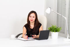 Young woman in the office. Young woman working in the office Royalty Free Stock Photo