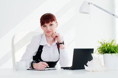 Young woman in the office. Young woman working in the office Stock Image