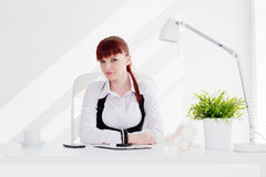 Young woman in the office. Young woman working in the office stock photo