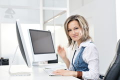 Young woman at the office. Beautiful young woman working at the office royalty free illustration