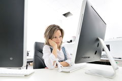 Young woman at the office Stock Photos