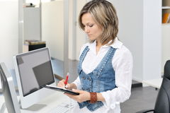 Young woman at the office Royalty Free Stock Photography