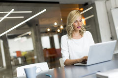 Young woman in the office Stock Image