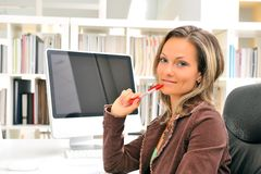 Young woman at the office Royalty Free Stock Images