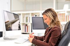 Young woman at the office Stock Image