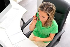 Young woman at the office Stock Photography
