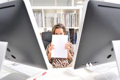 Young woman at the office Stock Images