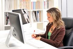 Young woman at the office Royalty Free Stock Photo