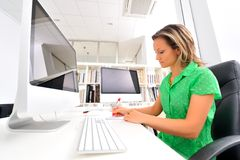 Young woman at the office Royalty Free Stock Photos