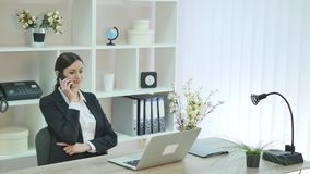 Young woman in the office stock footage