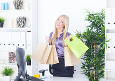 Young woman at office with beautiful bags Stock Photo