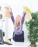 Young woman at office with beautiful bags Royalty Free Stock Images
