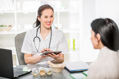 Young woman in an office at the doctor homeopaths. Stock Photo