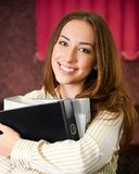 Young woman in an office with a folders Stock Photo