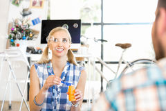 Young woman in office having fun Royalty Free Stock Photos