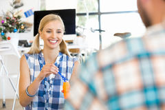 Young woman in office having fun Stock Photography
