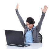Young woman in office jubilates and wins stock photo