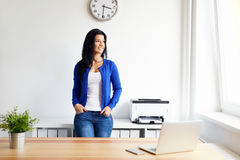 Young woman in the office Stock Photos