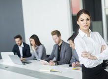 Young woman in the office Royalty Free Stock Image
