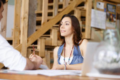 Young woman in office talking to her colleague Stock Photography