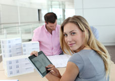 Young woman at office using tablet Royalty Free Stock Images