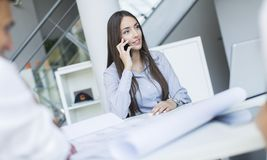 Young woman in the office Stock Images