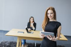 Young woman at the office Stock Photo