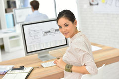Young woman office worker by the desktop computer stock photos