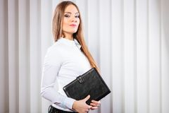 Young woman office worker hold case with files. Royalty Free Stock Photos