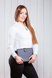 Young woman office worker hold case with files. Stock Images
