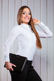 Young woman office worker hold case with files. Stock Photo
