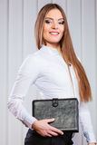 Young woman office worker hold case with files. Royalty Free Stock Photography
