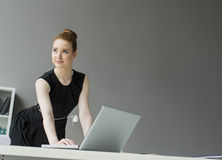 Young woman in the office Royalty Free Stock Photography
