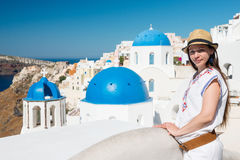 Young woman with Oia churches in background, Santorini Stock Photo