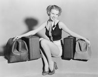 Young woman with old bags Stock Images