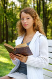 Young woman with old book Stock Photo