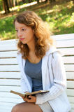 Young woman with old book Royalty Free Stock Photos
