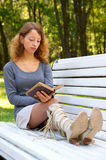 Young woman with old book Royalty Free Stock Image